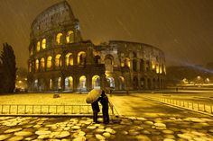 Snow falls at the Colosseum - Rome, Italy by Massimo Percossi