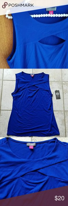 Vince Camuto top New with tags. Size medium. Beautiful sleeveless top. Really fun cut-out design in the front. Back is solid. Approximately 17 inches across armpit to armpit laying flat and 25.5 inches in length.  96% rayon 4% spandex. Vince Camuto Tops