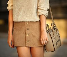 Knit neutral sweater, suede skirt, and tan leather Céline mini bag