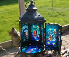 This Moroccan candle lantern features 6 pairs of cute cats, each pair sitting on the moon amid the glowing stars in the night sky. As you will see from the photos, the black cat visits the moon with first a white lady cat, then a ginger girl - he seems to be double dating! All hand