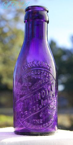 Small antique FREMONT Ohio GRAPE JUICE bottle in a by plowgirl