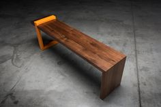 This sturdy bench is made from walnut wood and heavy-duty steel. They can be custom made to order in any size or color. The bench pictured here is 50 long, 18 tall and 13 deep   Custom made to order any size or color match