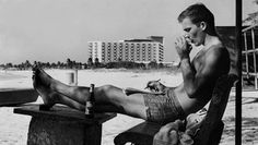 Hunter S. Thompson sipping on the beach.