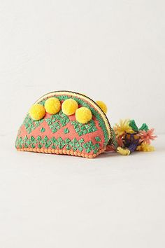 Super cute yellow pom pom coin purse. LOVE! Anthropologie