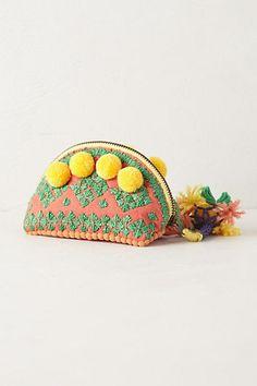 Super cute yellow pom pom coin purse.