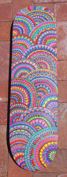 maybe a mandala print window would be cool.  This is a skateboard deck by Psychedelic Red on etsy.