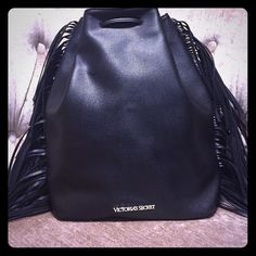 """Victoria Secret Fringe Backpack Style Bag Brand New with Tags! Drawstring bag from Victoria's Secret. Fun fringe detail and silver lettering. Measurements are 16' L x 6.3"""" W x 14"""" H. Victoria's Secret Bags Backpacks"""