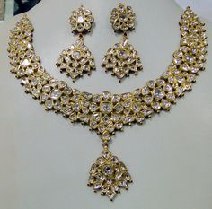"""22 carat solid gold, Old cut Diamonds and multi color Enamel work necklace (Kundan Meena choker)with Matching Earrings. A large necklace Ideal for special occasions set with eye popping clear old cut genuine Diamonds. A solid piece of jewelry good for family Heirloom which will last for ever. Multi color enamel at the back giving this piece a unique look of quality, great workmanship and great value for Money. Length of necklace -23 cm (9.05"""") Size could be adjusted according to your…"""