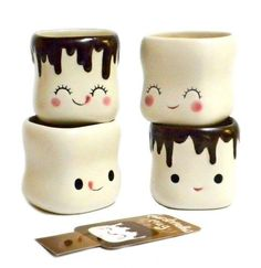 """A cup of hot chocolate will taste even sweeter in an adorable marshmallow mug! The perfect way to cozy-up on a cold winter night, each of these 4 ceramic mugs features a different funny face and a puffy marshmallow body. The perfect size for little hands, these mugs measure 2.5"""" high x 2.5"""" in diameter and are microwave and dishwasher safe. Each mug comes with its own hot cocoa recipe card for giving as gifts. Please note measurements, these mugs are smaller than the average mug."""