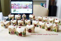 Custom order 20 gingerbread houses, no two are the same https://www.etsy.com/ca/listing/201057725/custom-made-to-order-needle-felted