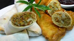 Cooked turkey meat gets an Asia-meets-Thanksgiving flavor when you roll it into prepared spring roll wrappers with stir-fried cabbage and garlic, then bake until crisp and serve with a cranberry-flavored dipping sauce.