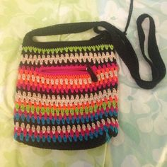Knit multi colored purse Knit multi colored purse. Satin inside. One pocket outside. Two small pockets inside. Well used. The Sak Bags Crossbody Bags