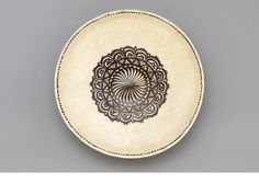 A Kashan Lustre-Glazed Star Tile, Persia, 13th century    fritware, white slip ground, with cobalt underglaze decoration, the design comprising a central floral bouquet within a lobed medallion and circle, the eight pointed edge with a band of islamic calligraphy