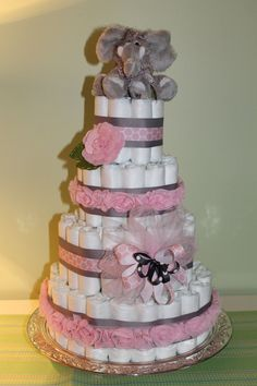 diaper cake!! Perfect for baby girls baby shower! Cute but need to lose the Elephant for something else!!!