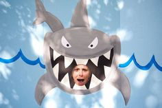 Shark photo booth!  I bought a blue cardboard trifold from Michael's for $5 and painted this in about an hour.