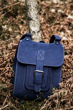 "Blue leather backpack. Handmade of hard and sturdy leather. 13"" size. Find out more on Etsy by InBagWeTrust"