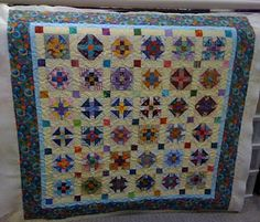 """""""Little Monkey"""" - bright scrap quilt with Monkey Wrench blocks from Quiltville"""