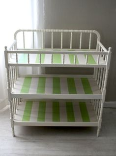 I love the painted stripes. What a great way to jazz up a plain white changing table.