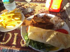 Spicy Doner Kebap with all the mezes (condiments and salads) plus chips......Pammukale, Turkey 2011