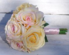 Yellow rose bouquet with subtle pink hues mixed in by Holly's Wedding Flowers.