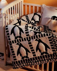 Aunt Joan!  My unborn children need this.  Actually, I just need this.  Penguin Frolic Baby Quilt