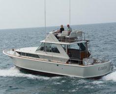 1965 Chris-Craft Commander 38 Sedan Bridge.   just like my boat but mine is a 1968 chris craft commander 47 without the fly bridge! :)