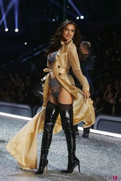 Black thigh boots and lingerie runway fashion