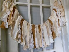 rustic romantic fabric banner, shabby burlap swag, lace fabric garland, lace strip banner, country farmhouse, rustic wedding, shabby home Lots of fabric and lace, new and vintage, along with burlap make up this banner. Its full of texture and is a versatile decor piece for home or party.  An ample number of fabric strips, knotted to jute, can be moved along the cord for more or less width as suits your needs. It can be easily tacked or tied in place.  Many of the textiles are true vintage…