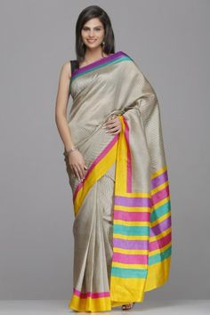 Rich Beige Raw Silk Saree With Subtle Zigzag Pattern And Yellow And Purple Striped Border