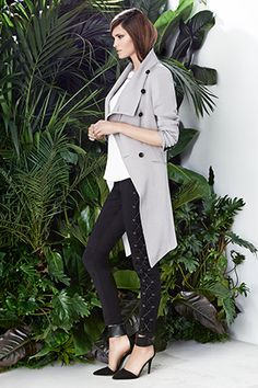 The Seda coat is a wardrobe essential. Cut from viscose dobby with a matte sheen this classic Spring coat has a draped asymmetric front and features Bastyan embossed buttoons. This coat will transcend seasons. Lourdes is 5