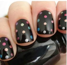 black + polka dot nail art.
