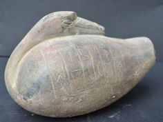 1–15. Black stone duck weight, c. 3000 BCE. The cuneiform inscription dedicates this weight to the god Nanna by the King of Ur and confirms a weight of five minas. A mina weighed about 0.6 kilograms, or 18 ounces.