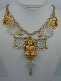 ASKEW LONDON BUDDHA, PAGODA AND MOTHER OF PEARL COUNTER NECKLACE