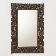 Tegan Carved Mirror. having mirrors in a room can make the space look bigger! i def need some of that. i LOVE the carvings on this