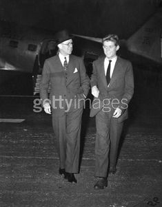 American diplomat and financier Joseph P. Kennedy, Sr. (1888 - 1969) (left) walks with his son, future US President John F. Kennedy (1917 - 1963) in Palm Beach, Florida, December, December 28, 1938. They walk away from a small passenger plane in the background. (Photo by Bert Morgan/Getty Images). For information about licensing this image, visit: Getty Images