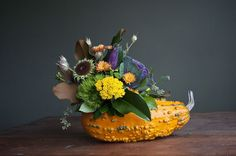 I love this unique fall floral arrangement using a gourd as a vase.  Perfect for a pretty  Thanksgiving centerpiece.