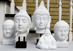DIY Anthropologie Buddha Heads - Just got a Buddha Head from the flea market recently... cant decide if I want to white it out or not.