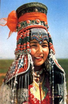 Mongolian woman traditionally dressed and adorned.