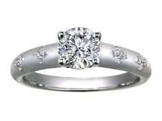 """He wooed you with flowers, carry the blossoms with you as you hold hands and say """"I Do"""" White Gold Blossom Ring - White gold 'Blossom' ring, $1,075 (setting only) at brilliantearth.com"""