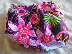 SassyCloth one size pocket diaper with Carnival Bloom PUL print. Made to order.