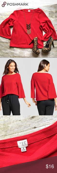 """NWOT A New Day Red bell sleeve top This red top can be easily dressed up or down. Bell sleeves. Textured fabric. 67/30/3 cotton, poly, spandex. 23.5""""L. 19"""" bust laying flat. New without tags. Size medium. *Heels and skirt pictured are also available in my closet, but the look and save! A New Day Tops"""