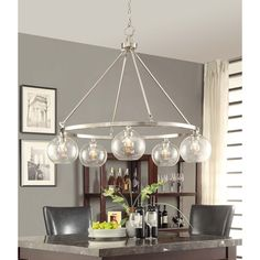 The Marisol 5-light chandelier offers industrial-chic appeal with a slender brushed nickel frame supporting five seeded glass shades housing retro Edison light bulbs. Modernize you living space with this contemporary light fixture. $234.59