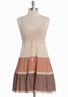 "Aurora Beaming Crochet Dress 43.99 at shopruche.com. Charming and delicate, this cotton blended dress in neutral tones of cream, brown, and peach features feminine crochet details and ties at the waist. Elasticized back. Fully lined., ,  Self: 75% Cotton, 25% Polyester ,  Lining: 100% Polyester,  Imported ,  36"" length from top of shoulder"