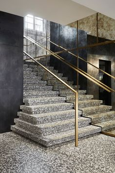 PARIS – Striking contrasts are at play in Humbert & Poyet's design for the 55 Croisette boutique in Paris. The industrial-chic interior juxtaposes bold decorative elements and raw materials. Stair Handrail, Staircase Railings, Stairways, Interior Staircase, Staircase Design, Railing Design, Modern Entryway, Entryway Decor, Granite Stairs