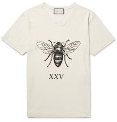 Perhaps a commentary on Mother Nature, or an extension of Mr Alessandro Michele's interest in fables and folklore, this slub linen T-shirt is printed on the back with the phrase 'Angry Forest'. A large bumblebee features at the front, positioned above the designer's lucky number in Roman numerals. Light distressing, a wide neckline and slouchy cut amp up the cool factor of this piece. Wear yours with slim trousers.