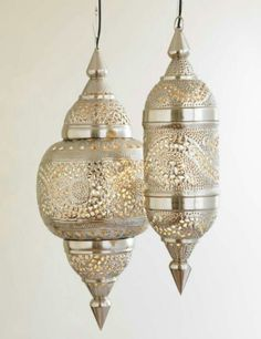 Arabesque stampled metal lanterns - beautiful reflected effects for your walls and jewelry for your space.