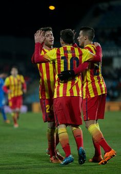 Lionel Messi (2ndL) of FC Barcelona celebrates scoring their second goal with teammates Cristian Tello (R) and Sergi Roberto (L) Dani Alves (R) during the Copa del Rey Round of 8 second leg match between Getafe CF and FC Barcelona at Coliseum Alfonso Perez on January 16, 2014 in Getafe, Spain.