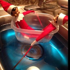 Elf on Shelf rowing a boat (Plastic container)