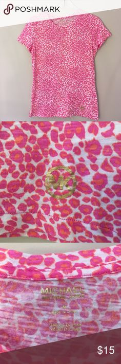 """Michael Kors Pink Leopard Print T-Shirt Medium This was worn twice. No condition issues. Shown on my size 6 mannequin. Underarm to underarm measures 18"""" inches. From back of neck to hem 25"""" inches. Sleeve length 6.25"""" inches. MICHAEL Michael Kors Tops Tees - Short Sleeve"""