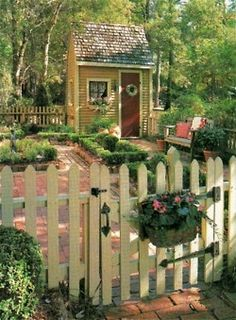 white picket fence and adorable gardens {I think maybe my perfect home would be cottages or cabins around a central entry/atrium/courtyard.  This would be perfect for a bathroom or closet}